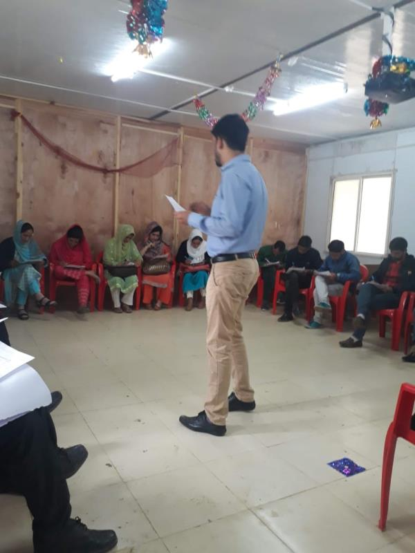 trainee instructs the teachers about new teaching methodology